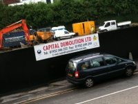 Capital Demolition - PVC Banner hemmed with eyelets